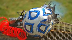 slow-motion-video-of-soccer-balls-being-overfilled-with-air-and-exploding_1